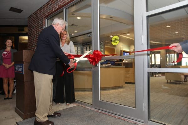 David F. Miller cuts the ribbon for the Retail Center