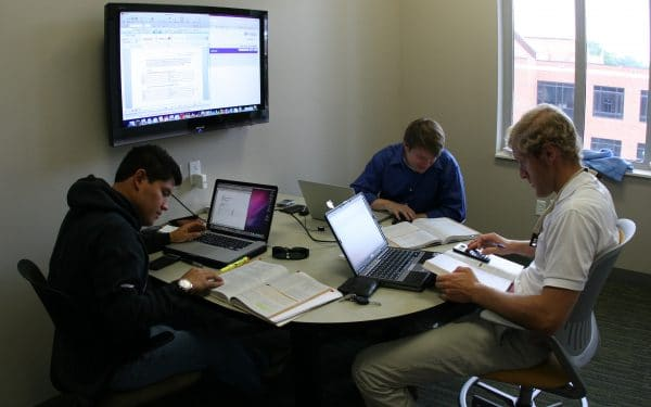 Students working on their laptops in a study area