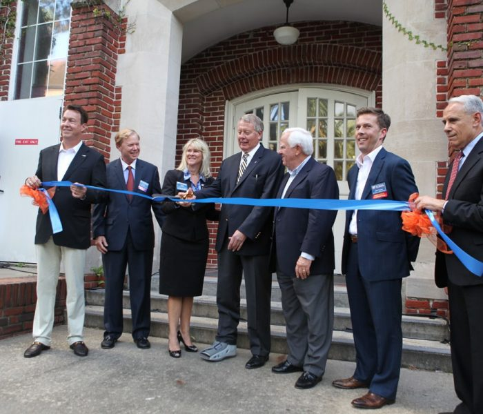 Kelley A. Bergstrom cuts the ribbon celebrating renovated Bergstrom Center for Real Estate Studies