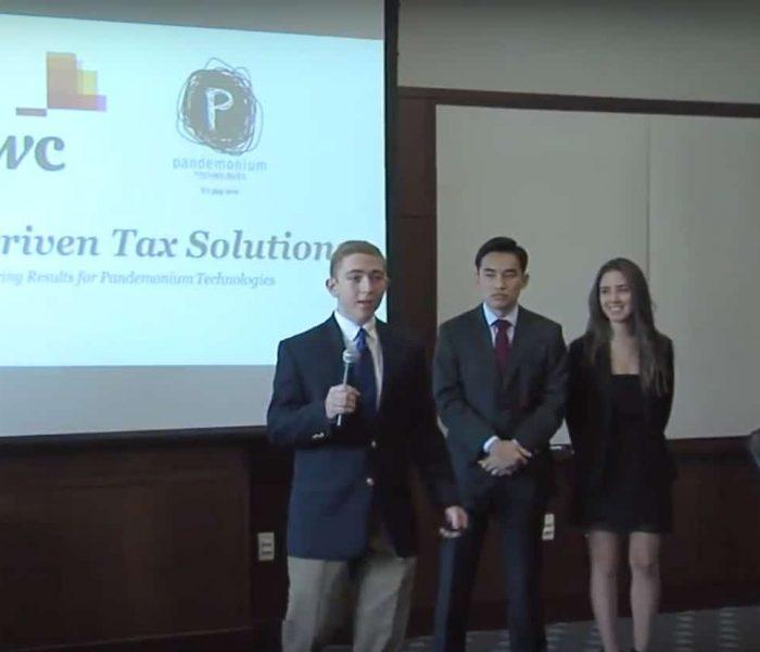 Nicholas LaVoy presents as teammates Richard Wang and Daniela Isturiz look on