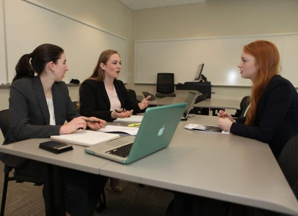 Barrie Eisenberg, Kristin Fanto and Kate Benesch prepare Heavener International Case Competition
