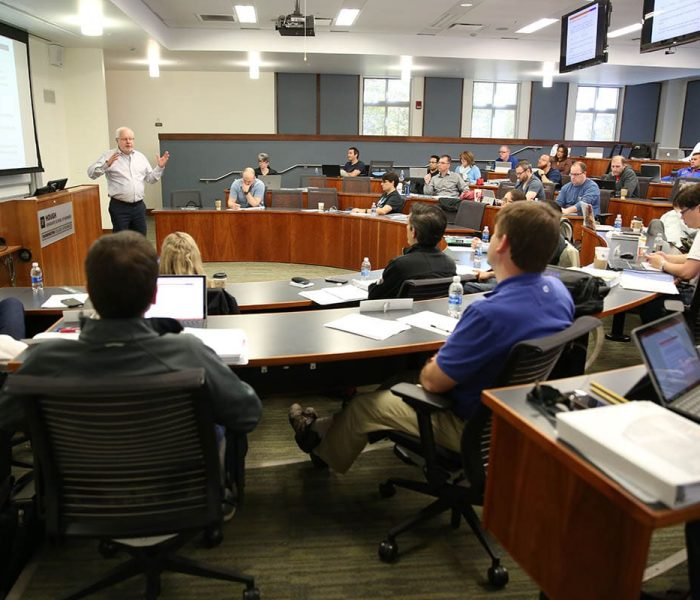 UF professor Brian Gendreau speaks to an MBA class.