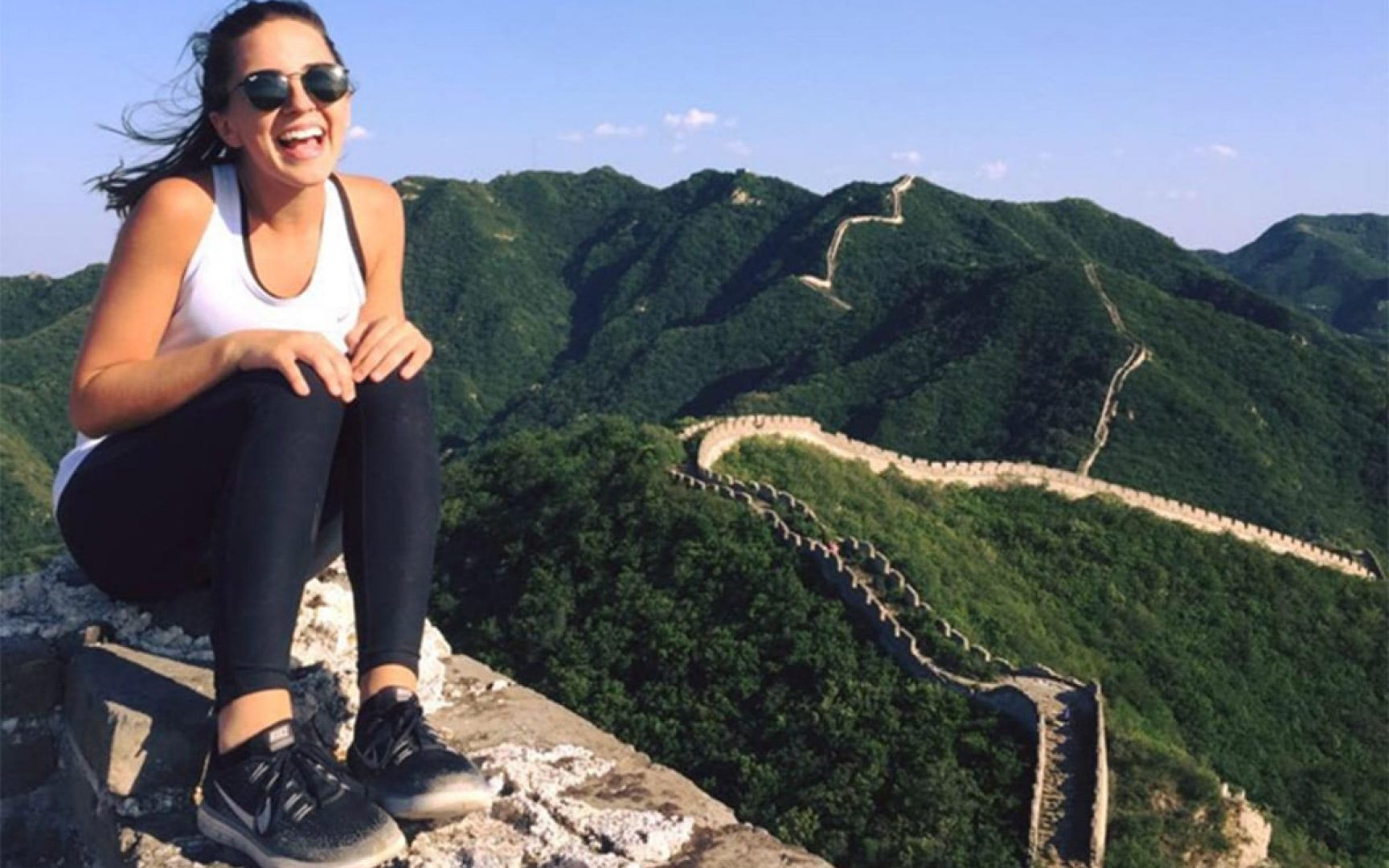 Alex Llodra in front of the Great Wall of China
