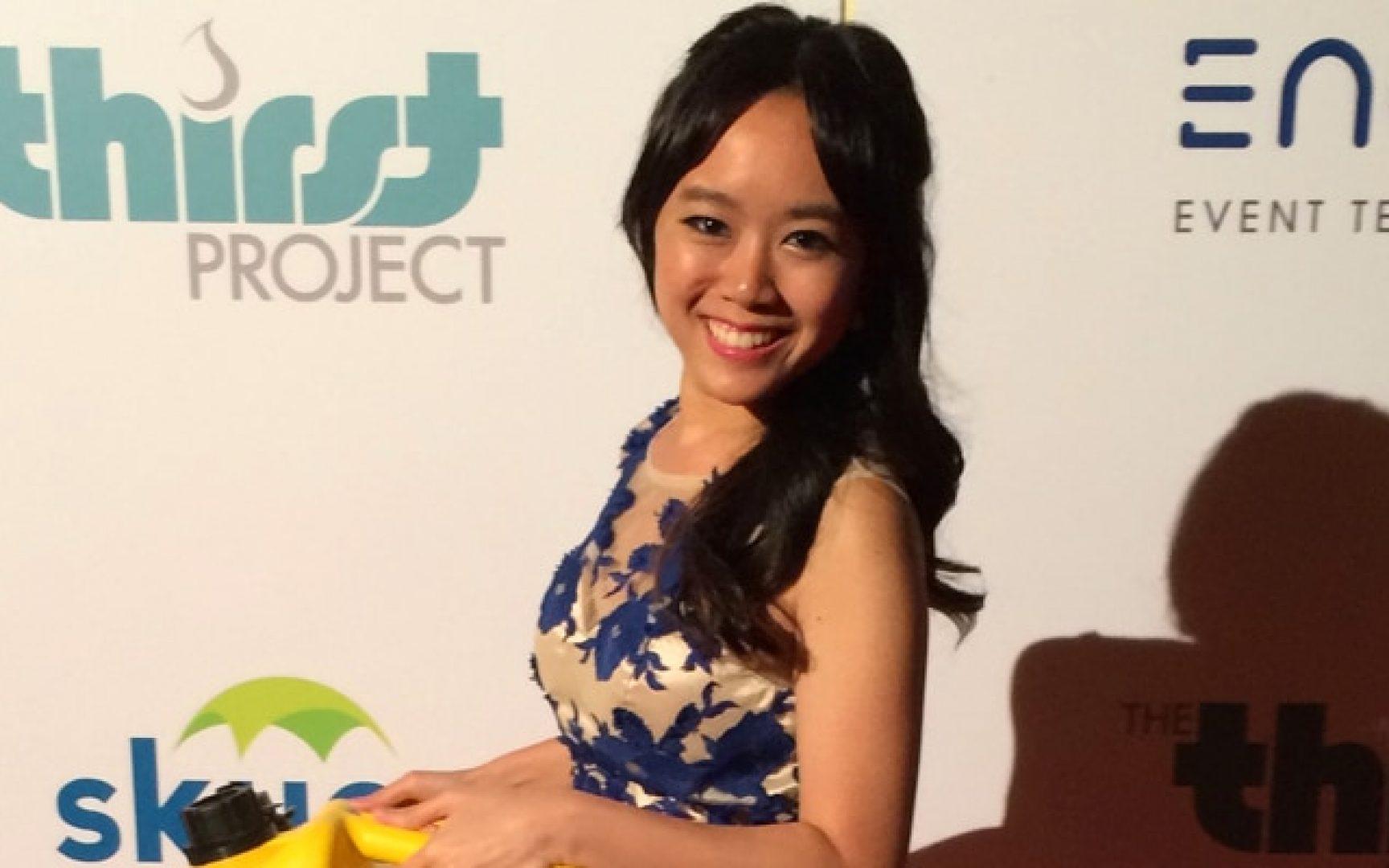Sylvia Lai holding an award