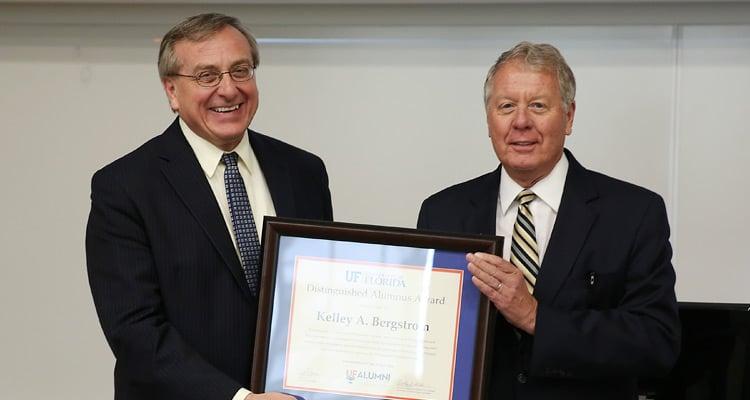 UF President Kent Fuchs handing an award to Kelley Bergstrom.