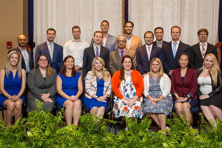 Group of 19 people sitting for a photo at the Outstanding Young Alumni Award Ceremony