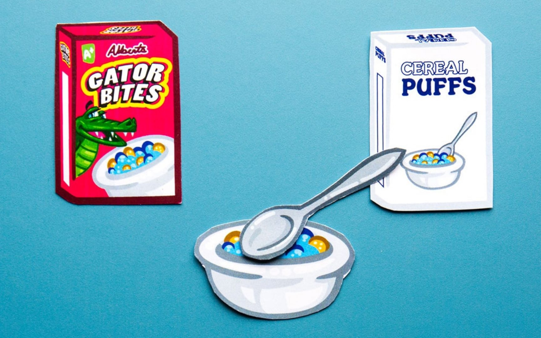 Cartoon-like drawing of cereal boxes and a bowl and spoon with cereal
