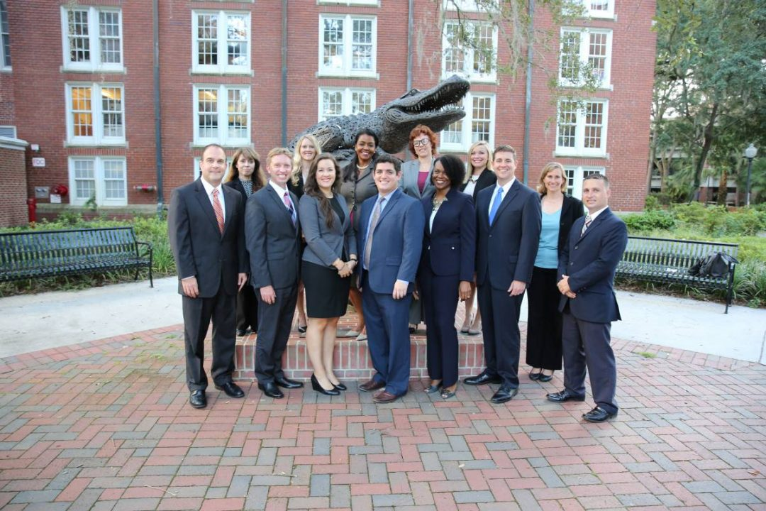 The Business Career Services Team poses for a photo in front of the Gator Ubiquity Statue