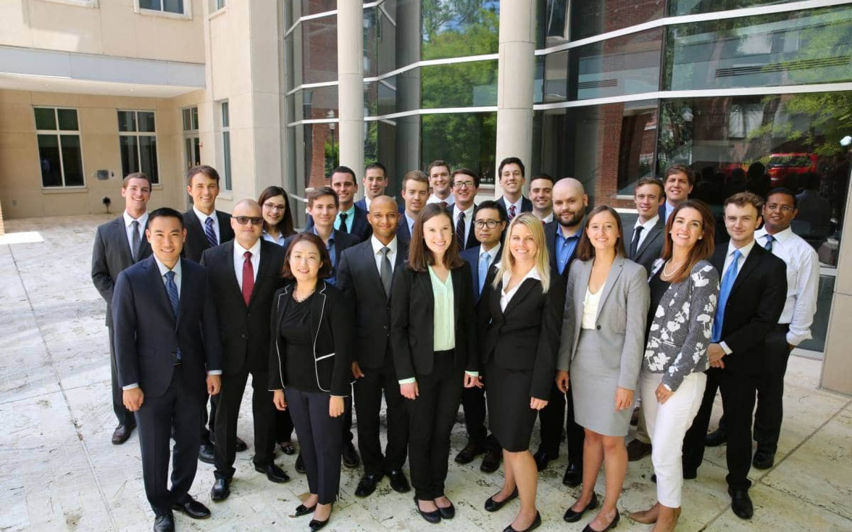 Group of Full-Time MBA students pose for a photo at Hough Hall
