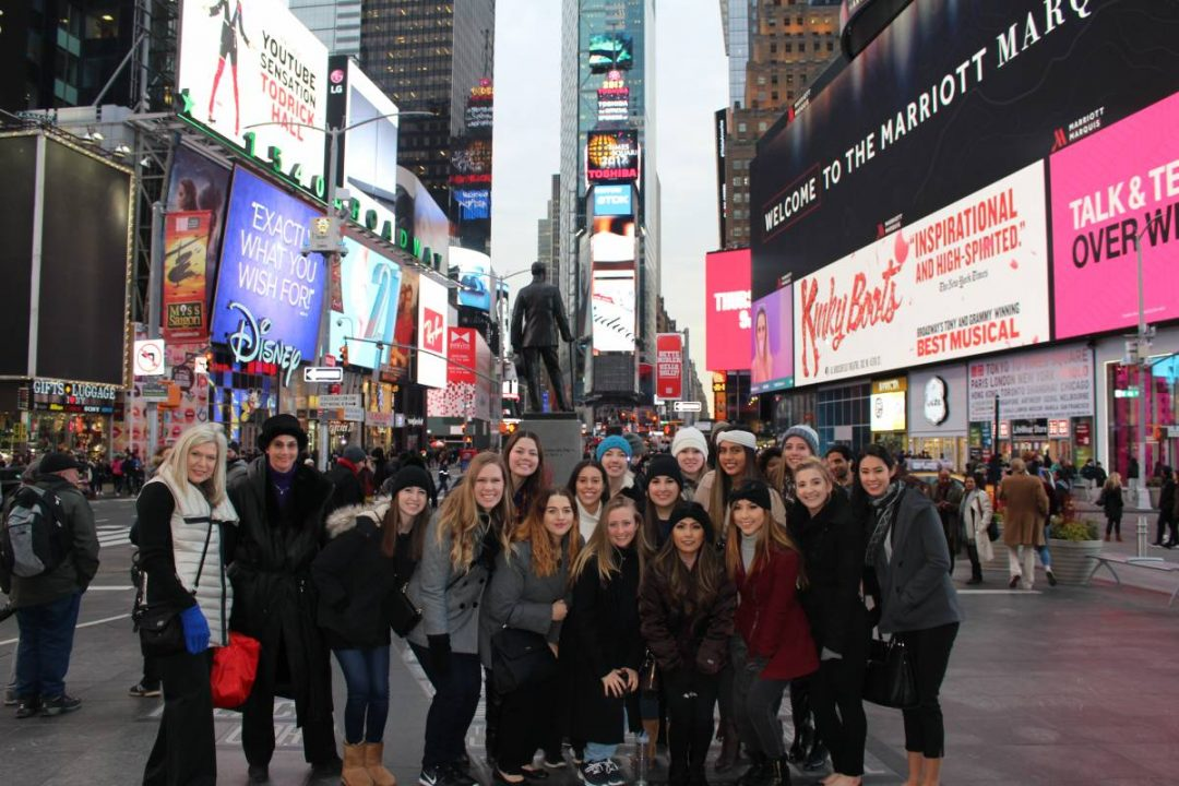 UF Retail students pose for a photo in Times Square