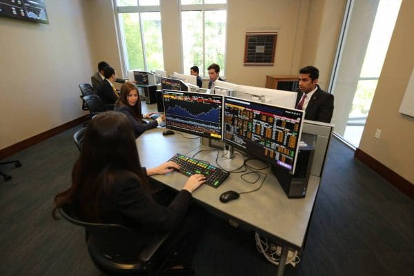Finance students sit at Bloomberg terminals in the Capital Markets Lab