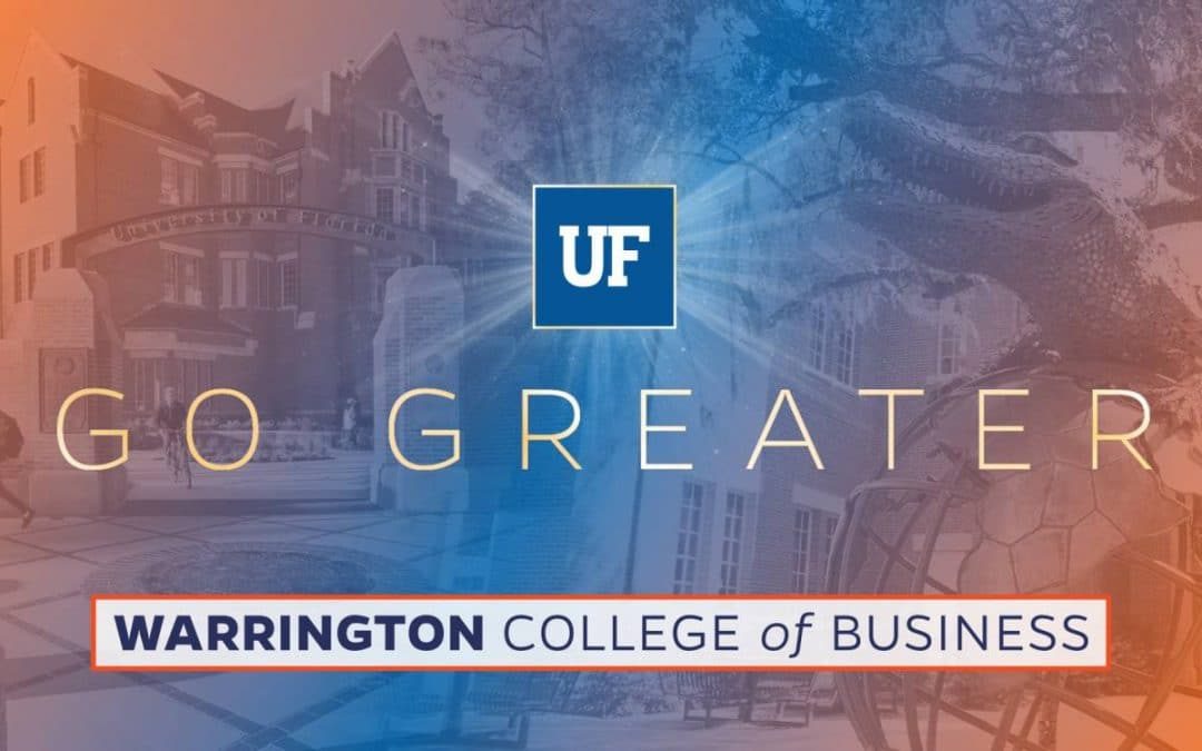 Heavener Hall and Gator Ubiquity Statue with the text Go Greater Warrington College of Business in the foreground