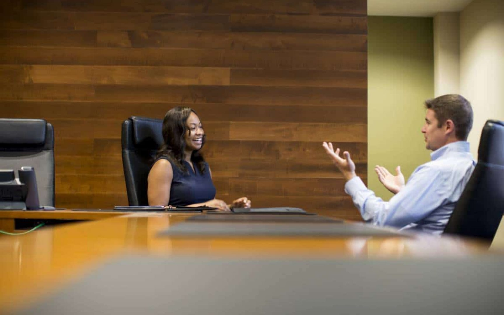 A UF MBA student talking with a member of the Career Services team in a boardroom