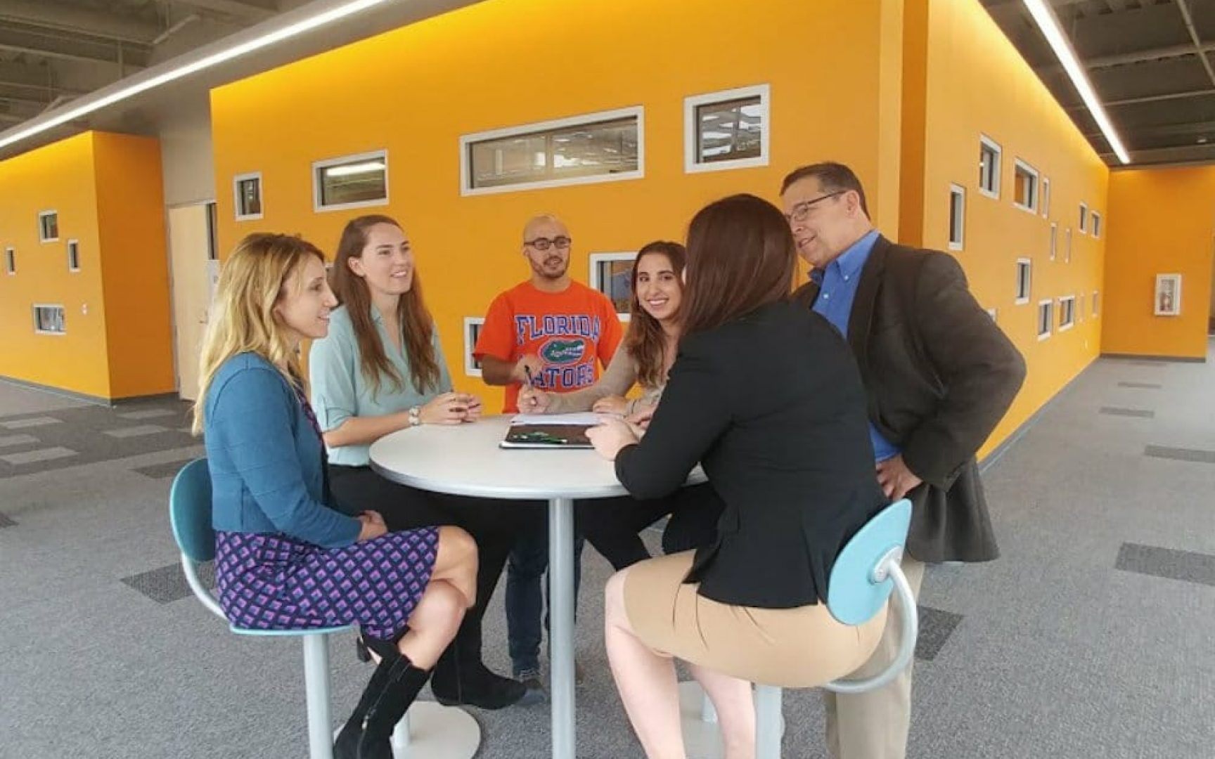 Students around a table in the Collaboratory-Square