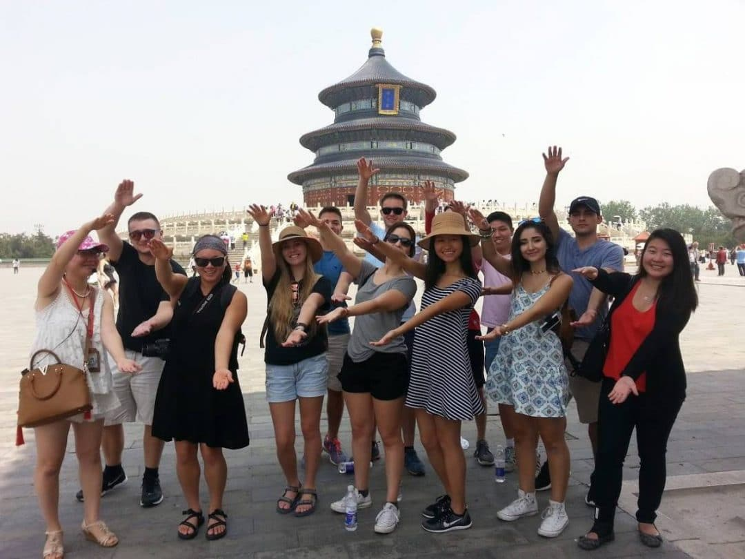 Group of UF students doing the Gator Chomp in China
