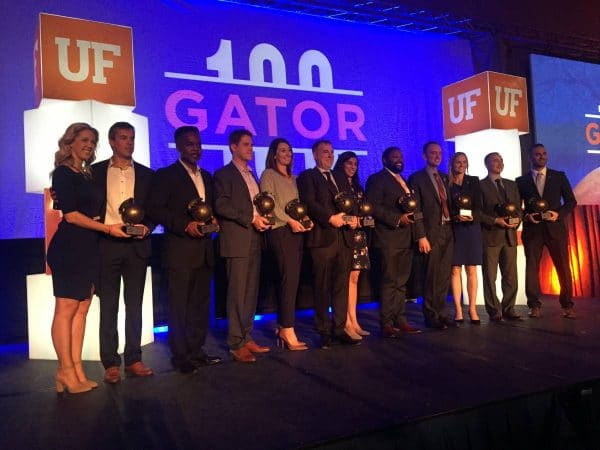 Gator100 award winners lined up on stage