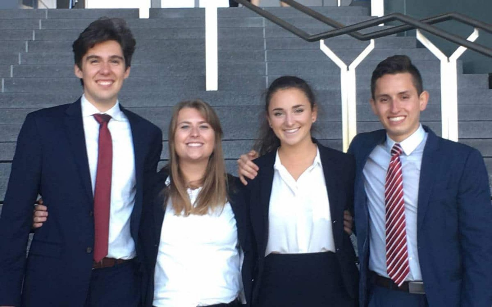 Four students pose for a photo at a case competition