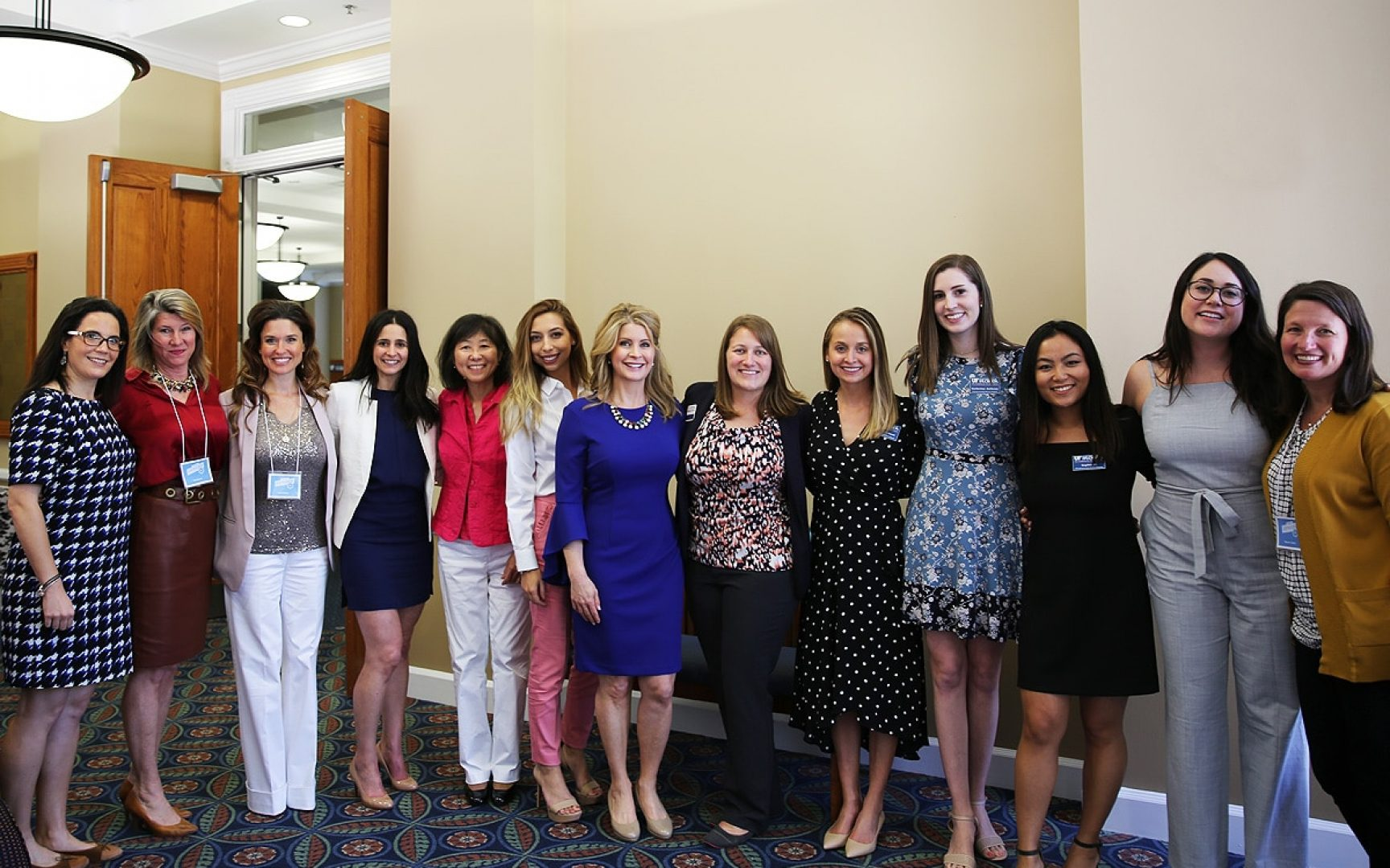 A group of women pose for a photo at the Women's Entrepreneurship Symposium