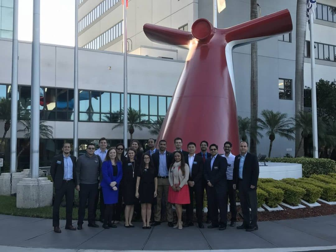 UF MBA students pose in front of the Carnival Cruise offices