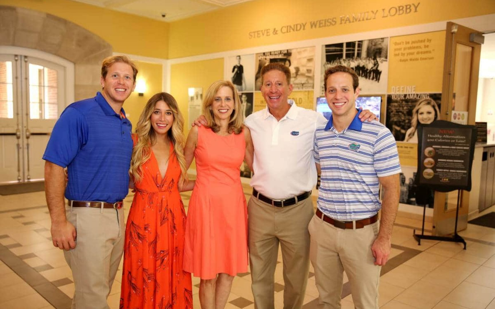 Steve and Cindy Weiss pose with their two sons and daughter in the Steve & Cindy Weiss Family Lobby in Heavener Hall