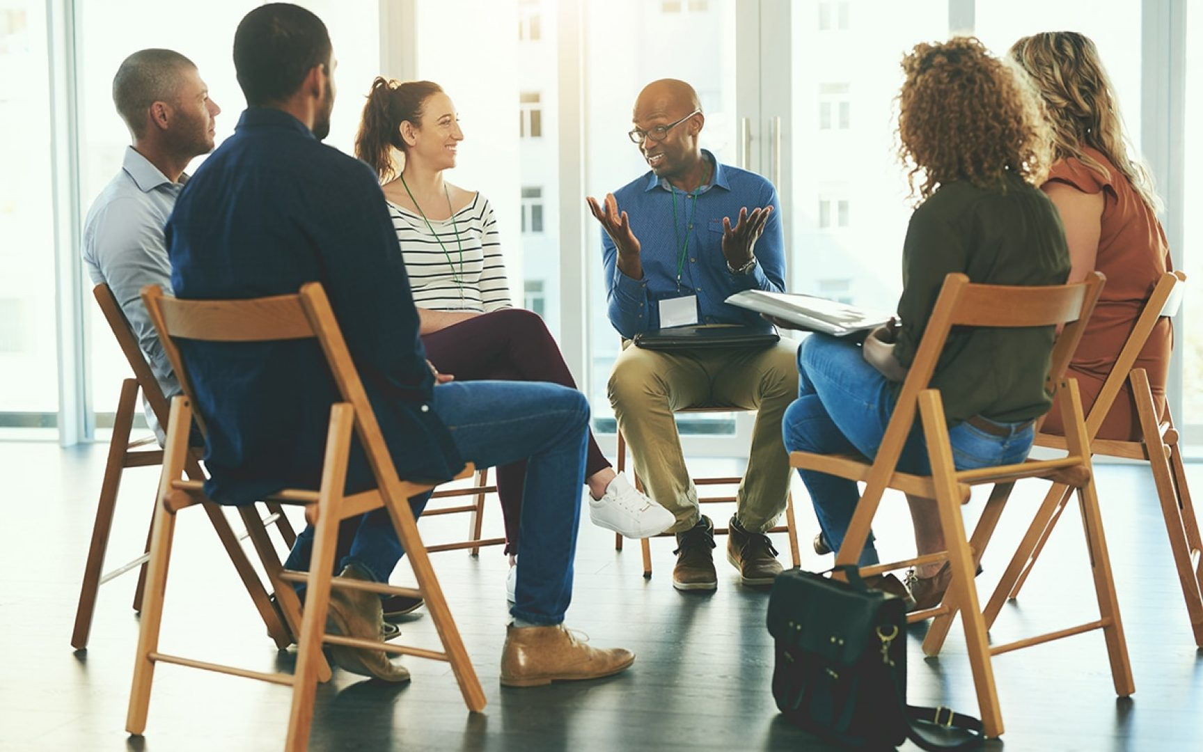 Small group of people talk in a circle