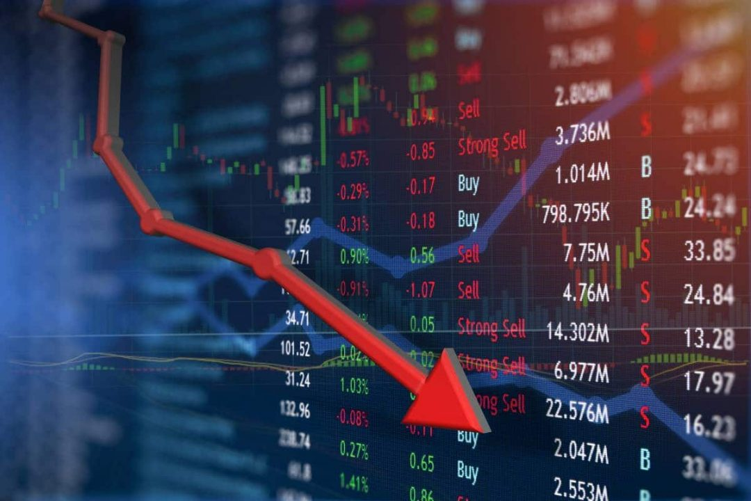 Red arrow pointing down over a stock ticker board