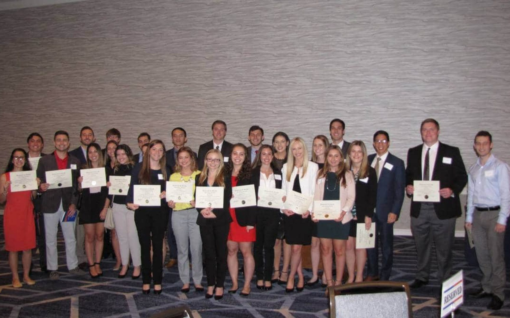 Fisher School students pose for a photo at an award banquet
