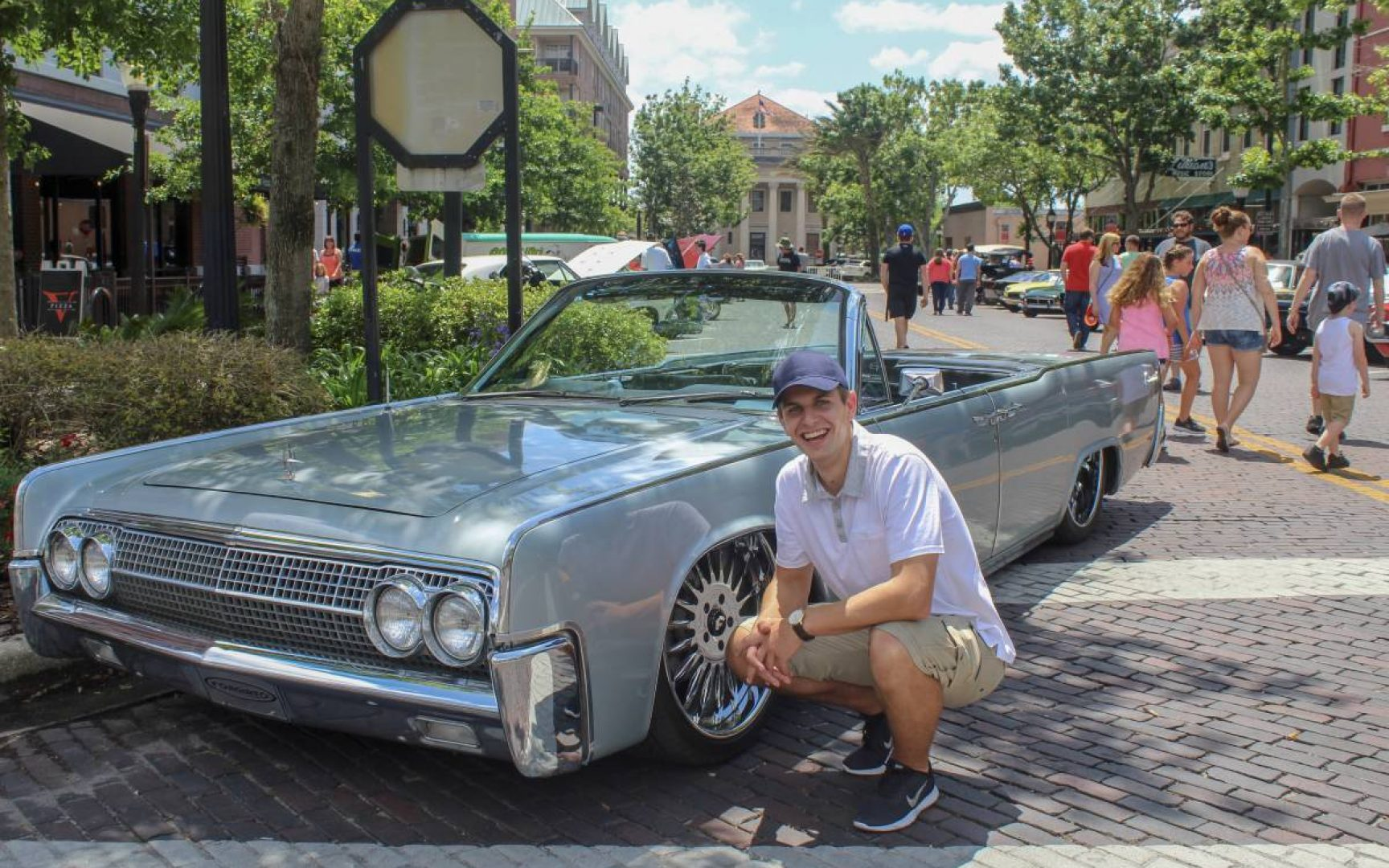 Michael Cizek poses with a classic car