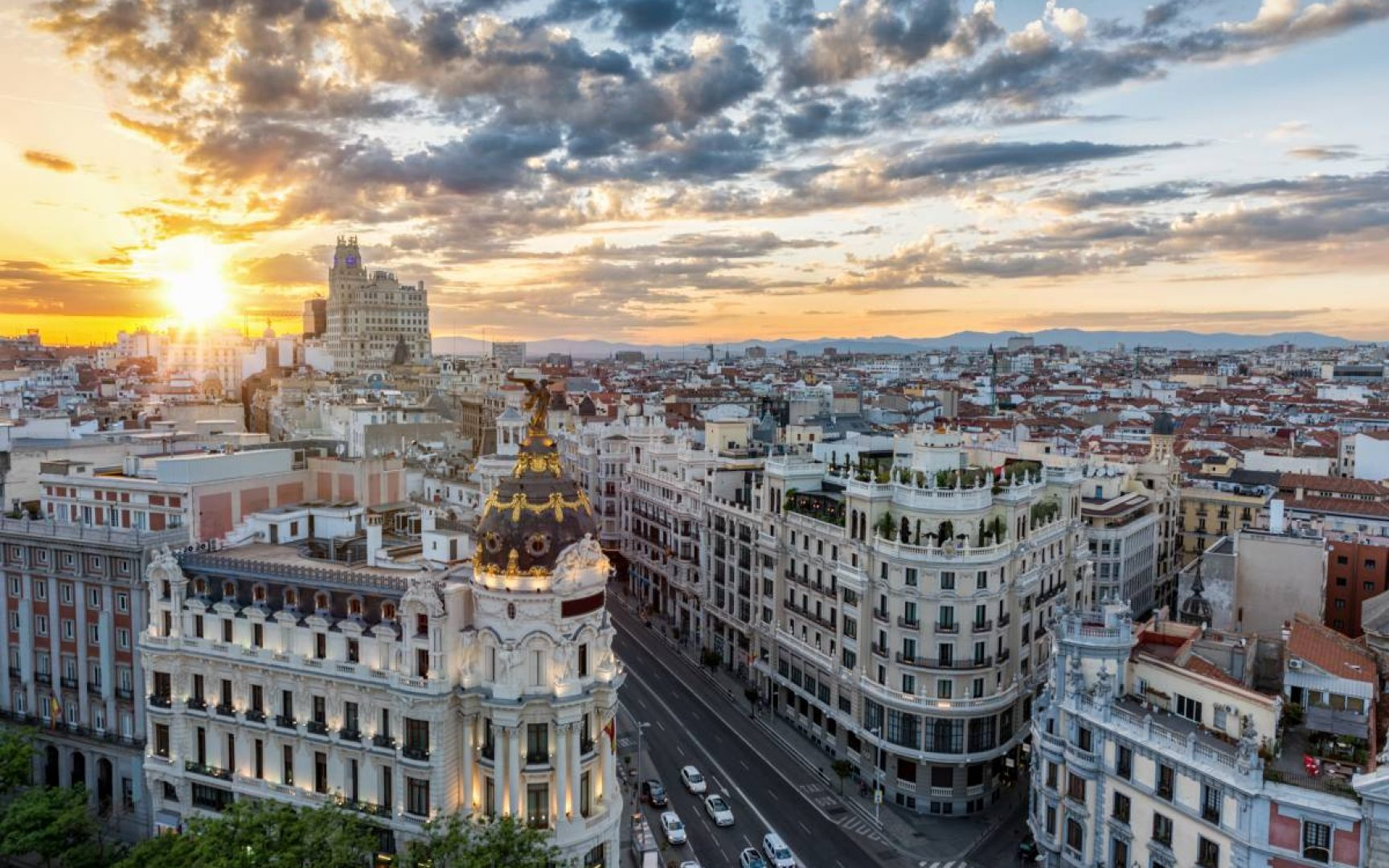 Madrid skyline with the sun setting in the background