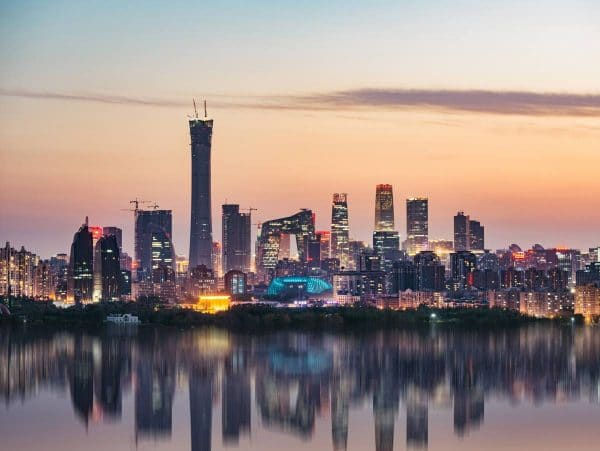 Beijing skyline with large skyscrapers overlooking a river