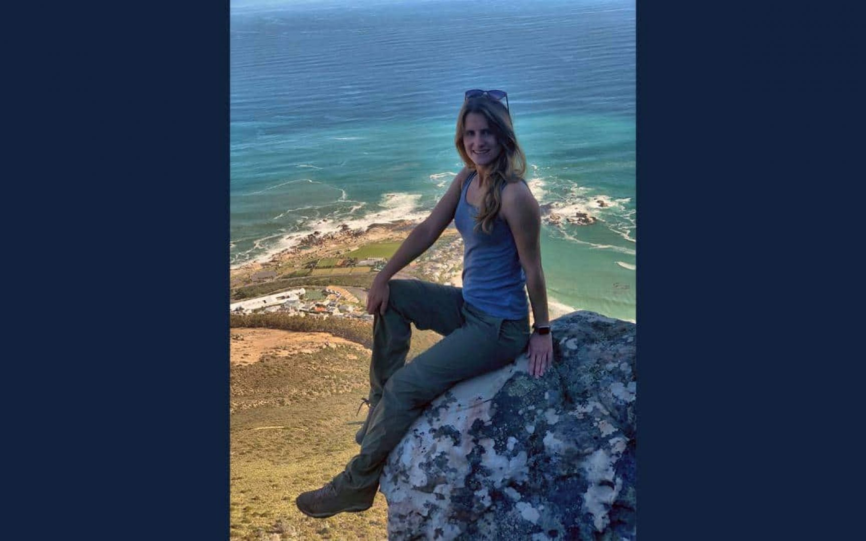 Stefani Harrison sits on a rock in South Africa