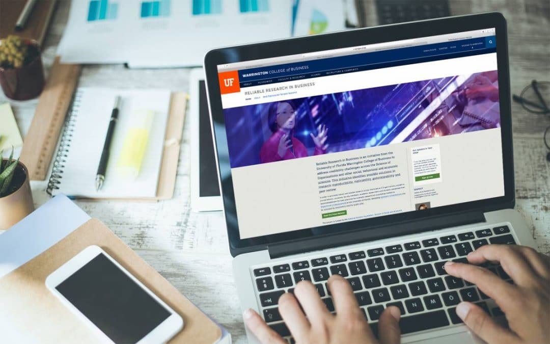 Laptop with Reliable Research in Business website displayed