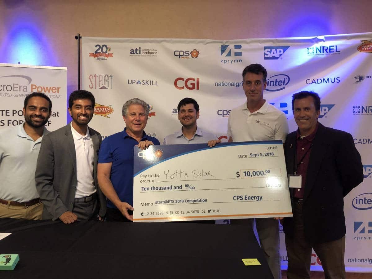 Mitch Jacobson with Austin Technology Incubator winners Yotta Solar