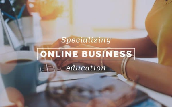 Computer screen with person typing. Text on top of the photo that says Specializing Online Business Education.