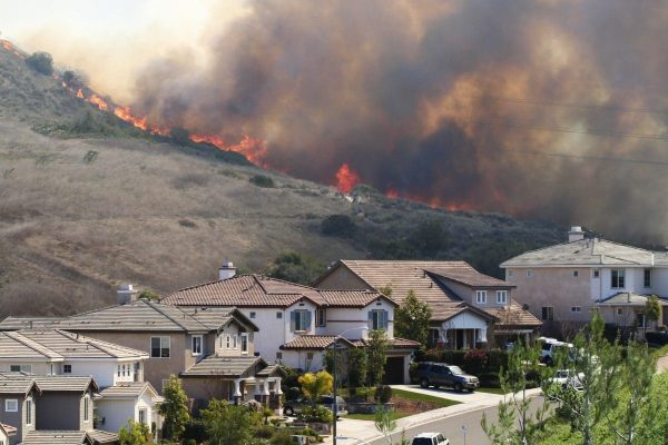 Image of fire very close to homes in California.