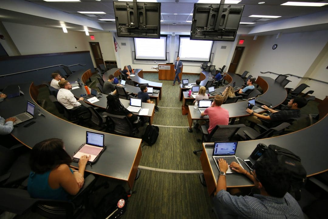 UF MBA students listening in class to Professor Anthony Coman.
