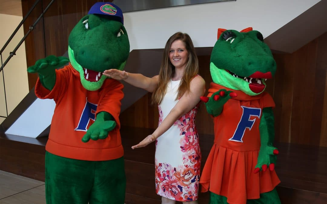 MSM student Ashley Owens with Albert and Alberta doing the Gator Chomp.