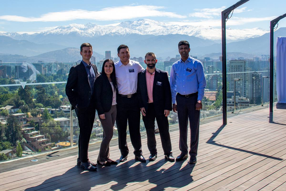 UF MBA South Florida students in Santiago, Chile with the city and mountains in the background
