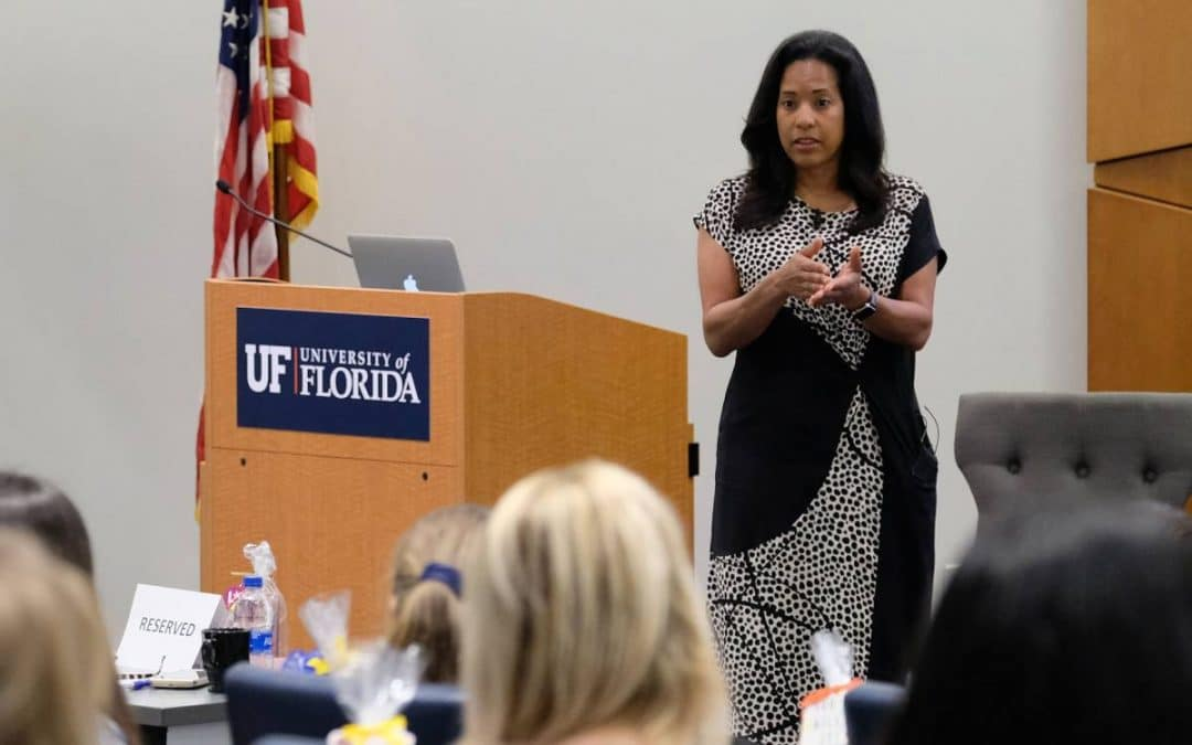 Michelle Ebanks speaks to a group of students in a classroom