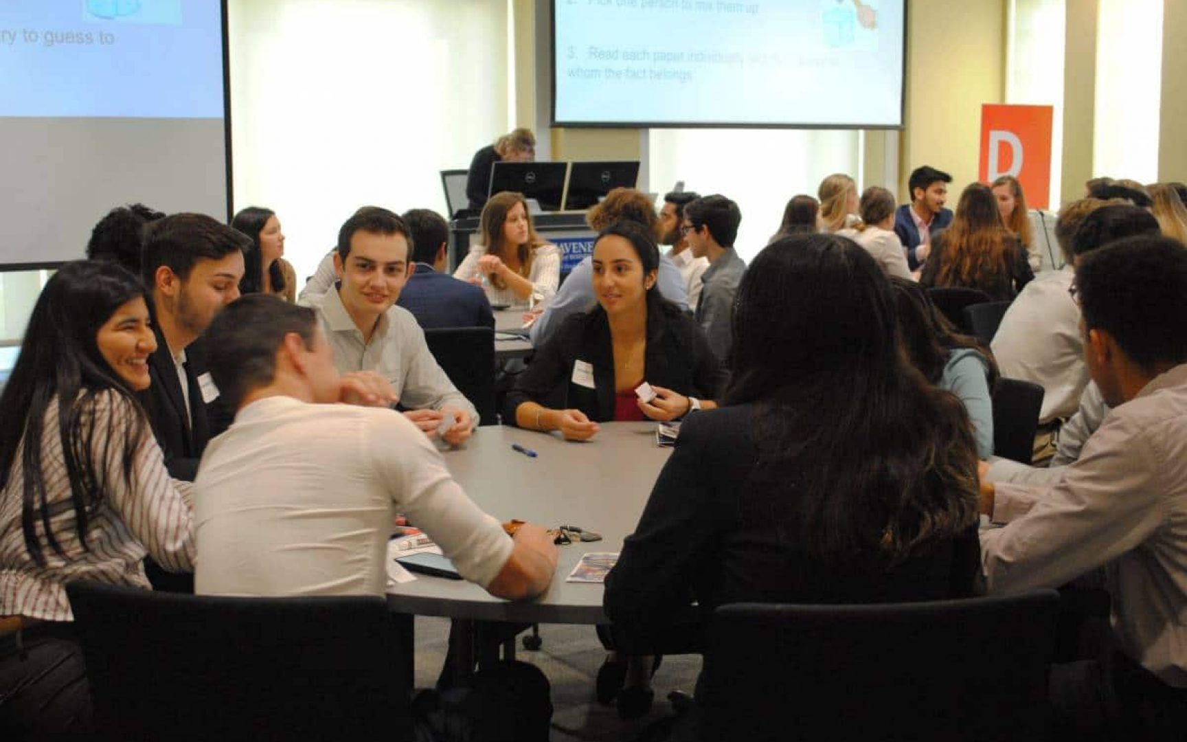 Group of students sitting at a round table talking