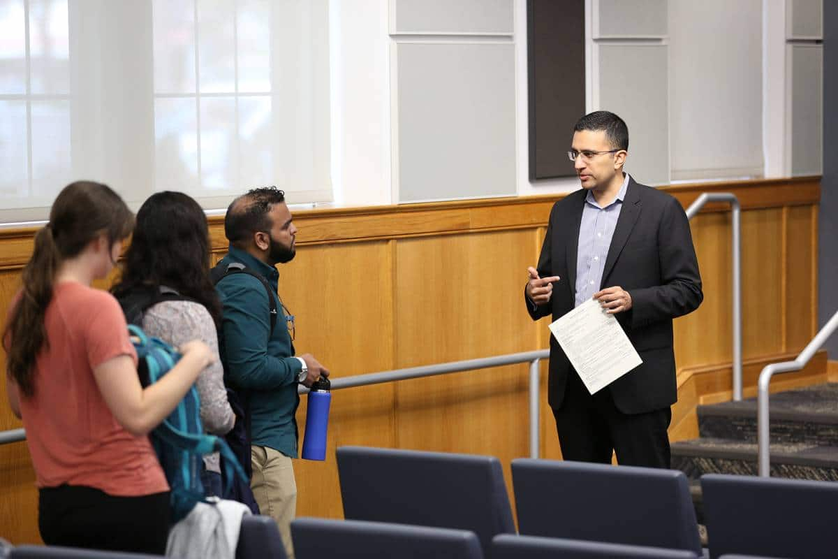 Charles Carmakal speaks to students in Dr. Praveen Pathak's class about the current cybersecurity landscape in February 2019.