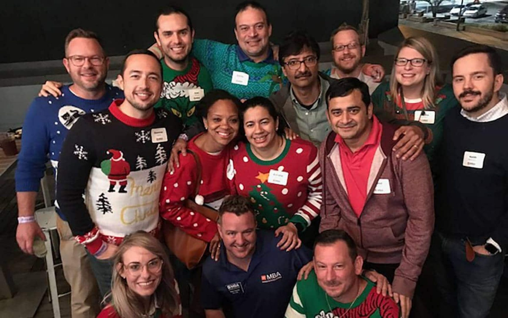 Group of UF MBA students wearing Christmas Sweaters