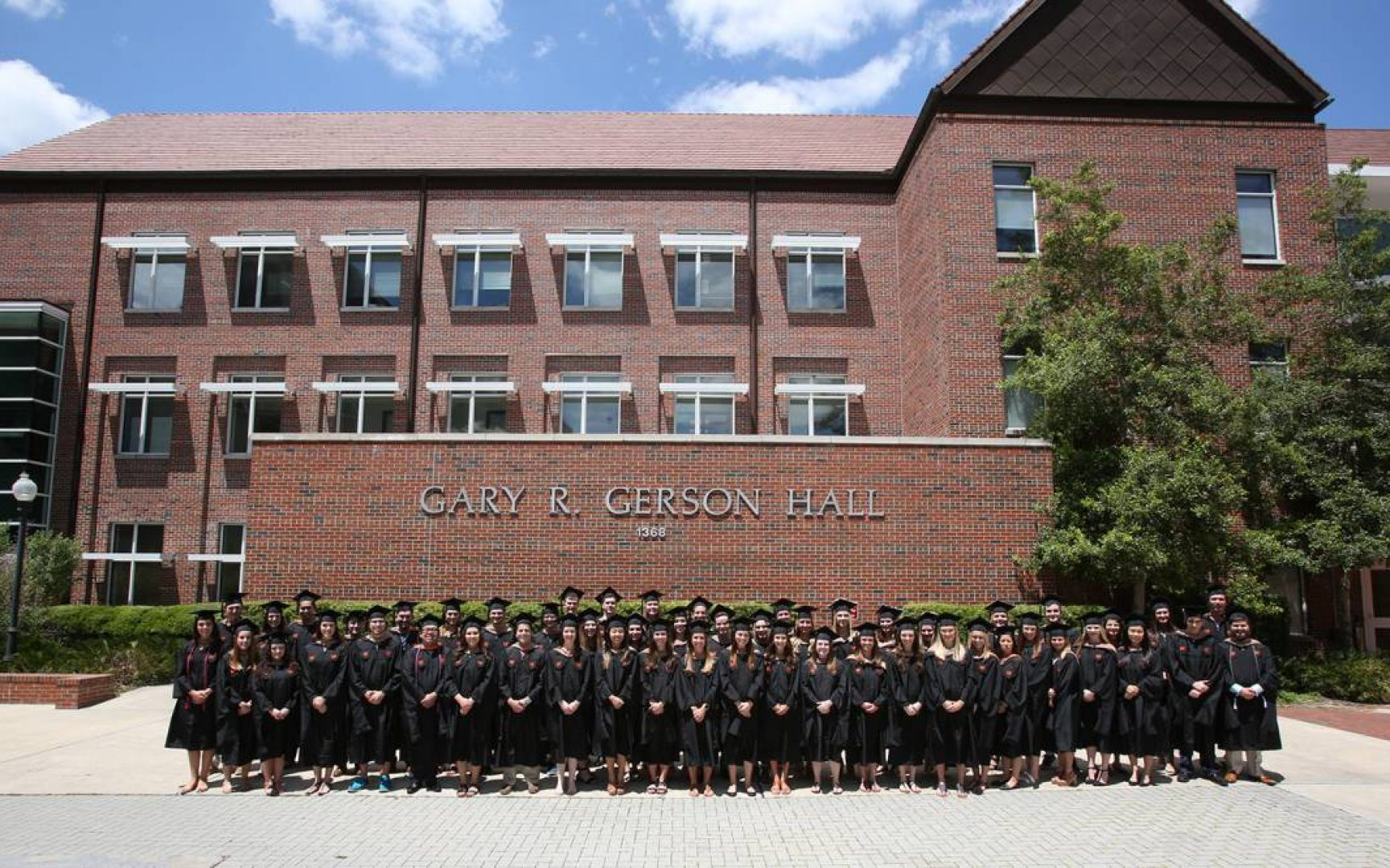 Fisher School of Accounting graduates line up in front of Gerson Hall, where the Fisher School if housed.