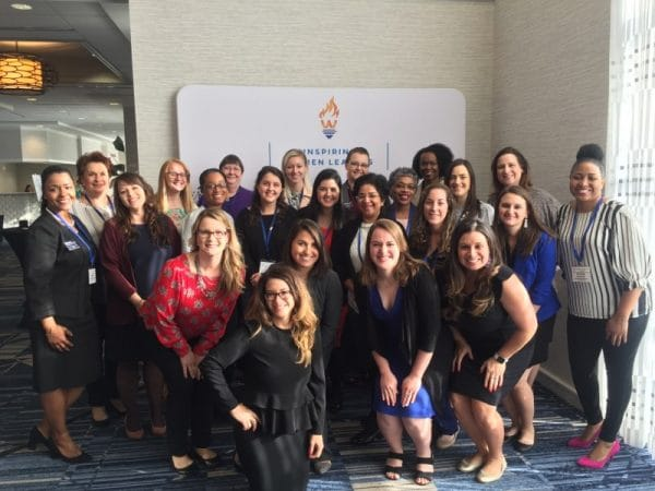 Staff from the Warrington College of Business pose for a photo at the Inspiring Women Leaders Conference.