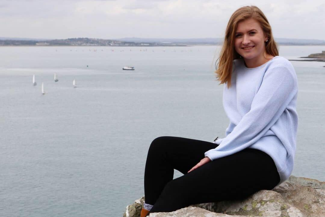 Jennifer Hilsdon poses next to a large lake.