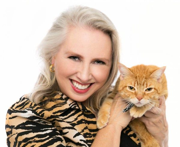 Lynn Maria Thompson author speaker in tiger jacket with cat