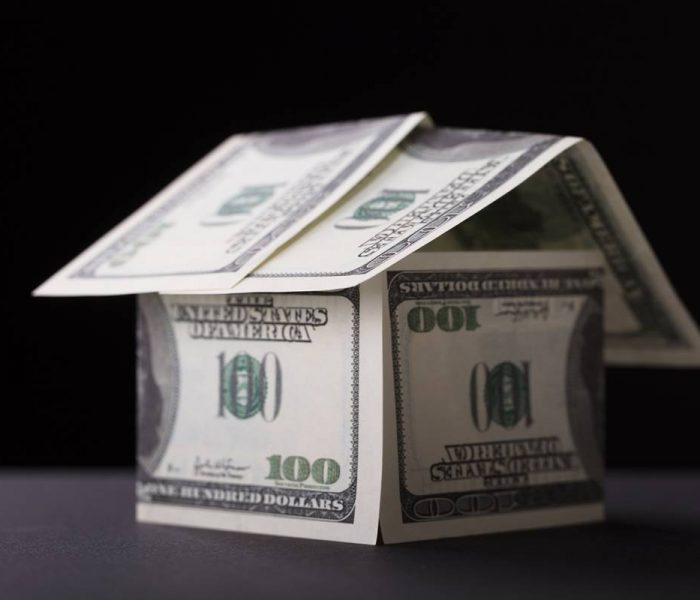 Close-up Of A House Made Up Of Banknote On Black Background