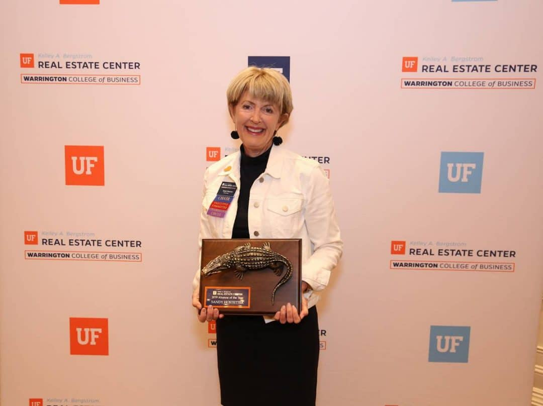 Sandy Hostetter with her Alumnus of the Year Award.