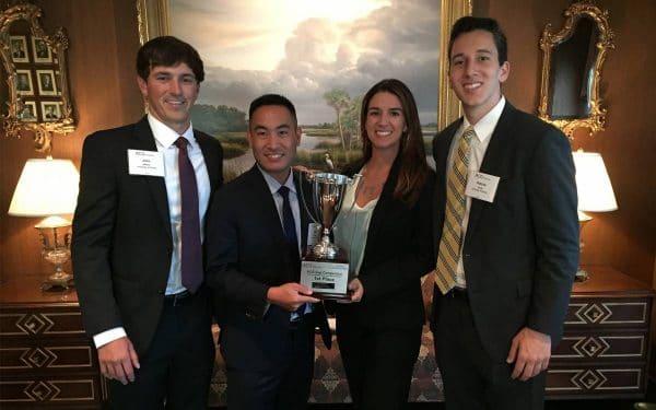 From left: UF MBA students John Wilson, Miki Hirama, Carolina Perez and Patrick Doyle with the ACG Cup.