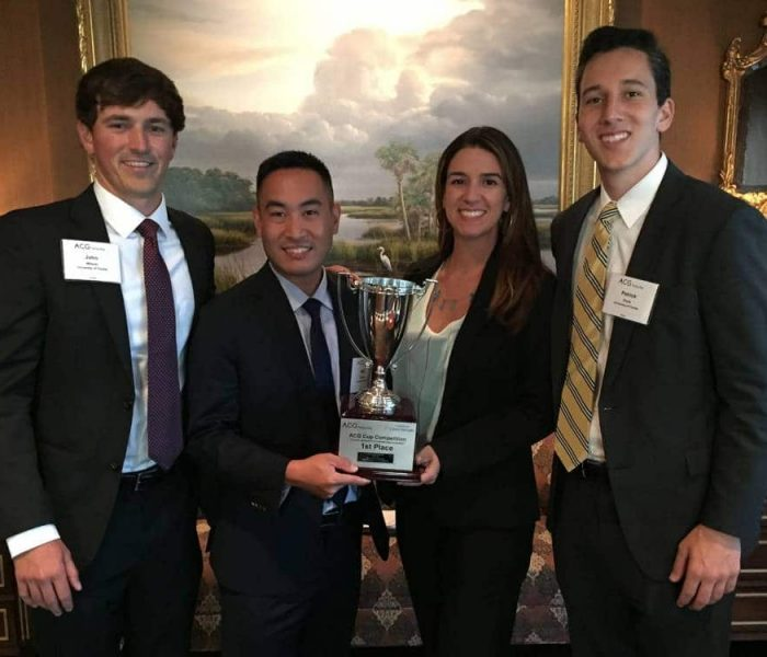 From left: UF MBA students John Wilson, Miki Hirama, Carolina Perez and Patrick Doyle with the ACG Cup.